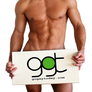 Naked muscular man covering with a box isolated on white